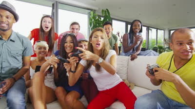 stock-footage-happy-group-of-friends-socializing-at-home-and-playing-video-games
